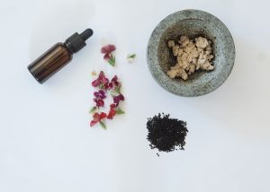 black-seeds-fresh-flowers-a-bottle-and-a-mortar