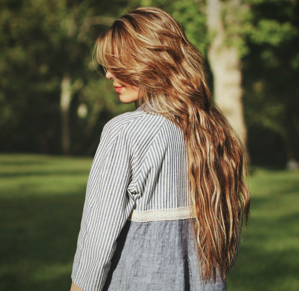 A glyceryl oleate formula in hair products is capable of rendering a natural looking shine without creating an artificial coating.