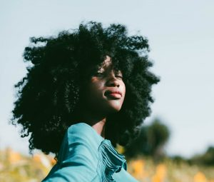 Natural shea butter hair products help add moisture to different hair types, including tightly curled, Afro-textured hair